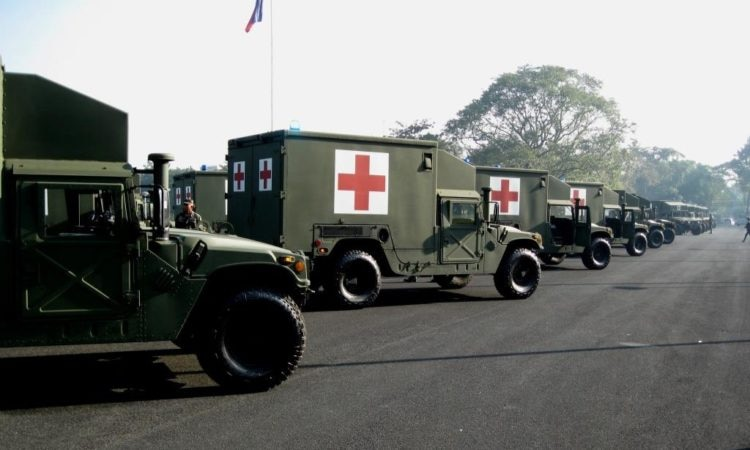 "23 HMMVW ""Humvee"" Ambulances are pre-positioned at General Headquarters, Camp Gen Emilio Aguinaldo in preparation for today's ceremony. The ambulances are equipped with an ambulance shelter and medical equipment set that includes one oxygen tank, a first aid kit and two stretchers. The capability allows for immediate medical response to wounded soldiers before being transported a higher level of care."