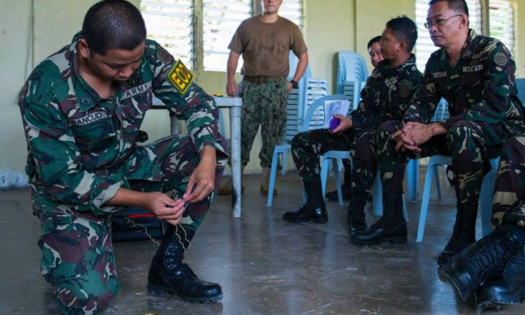 Philippine Army Staff Sergeant Noverth Buenaventura and U.S. Navy Explosive Ordnance Disposal 1st Class James Varner, from EOD Mobile Unit 5 stationed in Guam, examine an inert Improvised Explosive Device during a Humanitarian Mine Assistance (HMA) Level One training course. The HMA program provides increased humanitarian mine action assistance to countries suffering from the presence of persistent landmines, which maim and kill innocents, obstruct emergency assistance activities, hamper economic development and impede free movement of citizens. (U.S. Navy photo by Mass Communication Specialist 2nd Class (EXW) Timothy Wilson/Released)