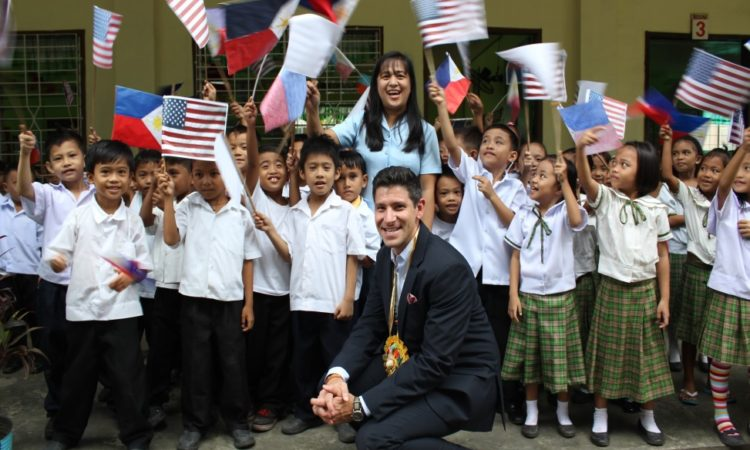 USAID Senior Advisor to the Administrator John Spears is warmly received by the students of Cogon Elementary School.