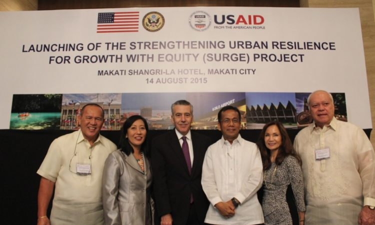 Ambassador Philip S. Goldberg (3rd from left) and USAID Mission Director Gloria D. Steele (2nd from right) together with (L-R) Cagayan de Oro City Mayor Oscar Moreno, Zamboanga City Mayor Beng Climaco, Socioeconomic Planning Secretary Arsenio Balisacan, and Puerto Princesa City Mayor Lucilo Bayron during the launch of USAID's SURGE project.