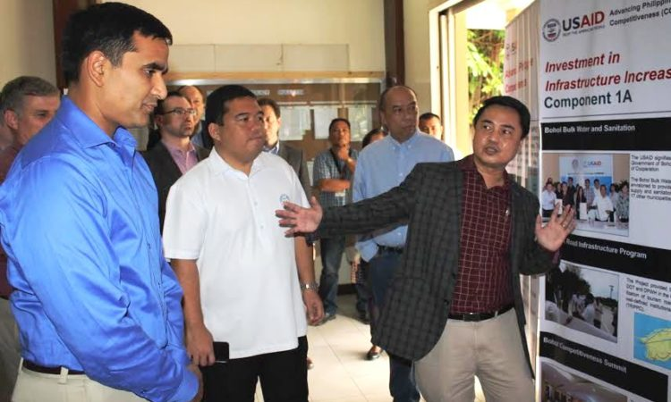 While in Tagbilaran City, Office of U.S. Foreign Assistance Resources Director Hari Sastry visited projects contributing to United States Agency for International Development's (USAID) Cities Development Initiative. Pictured here, Dr. Henry Basilio, Chief of Party of USAID's Advancing Philippine Competitiveness Project explains to Mr. Sastry how USAID is enhancing the competitiveness of key industries, such as tourism and agribusiness, in Tagbilaran and throughout Bohol